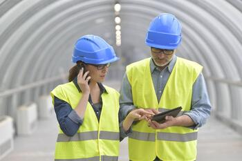 field workers using tablet and mobile phone