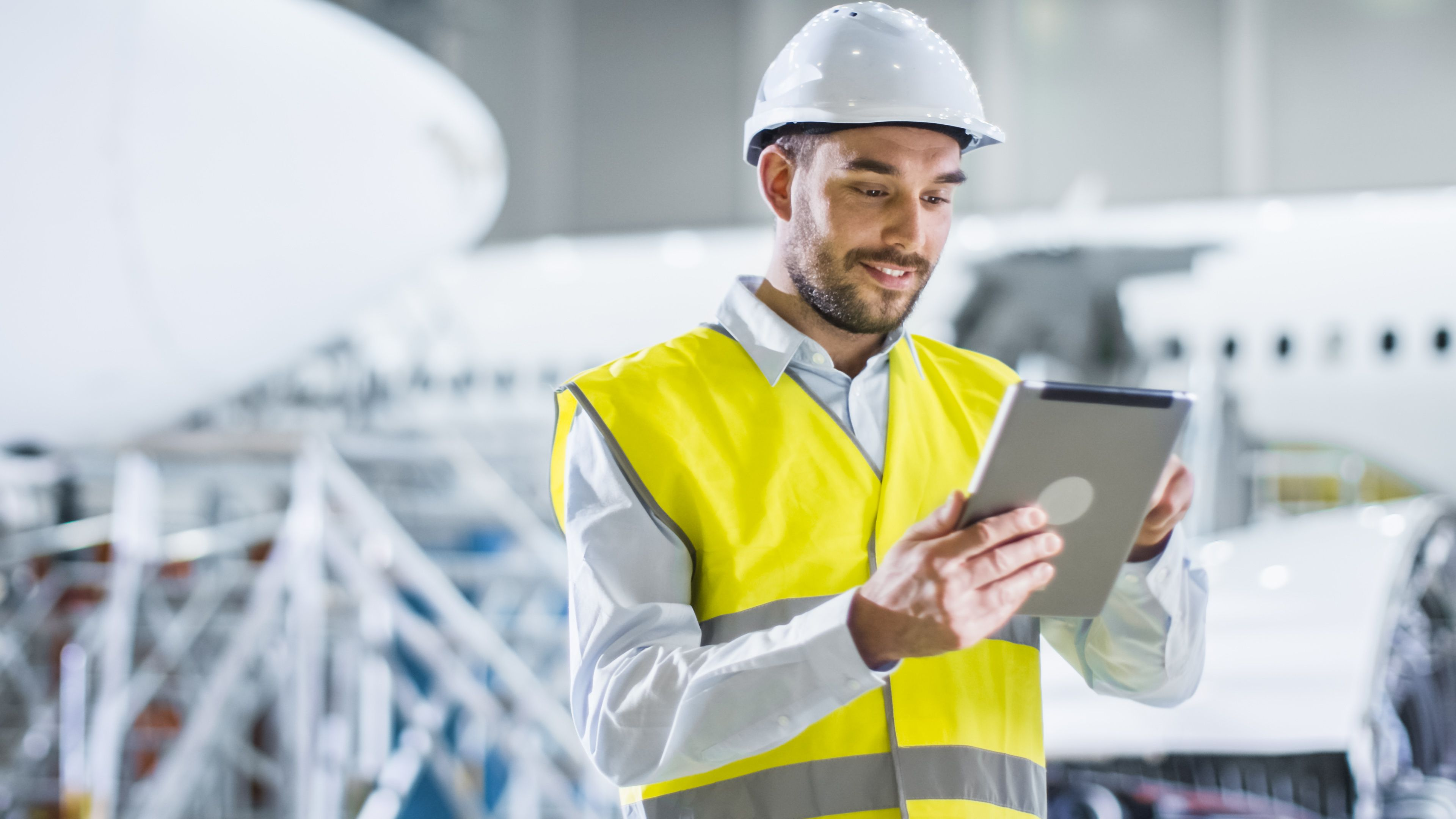 connected factory worker with tablet