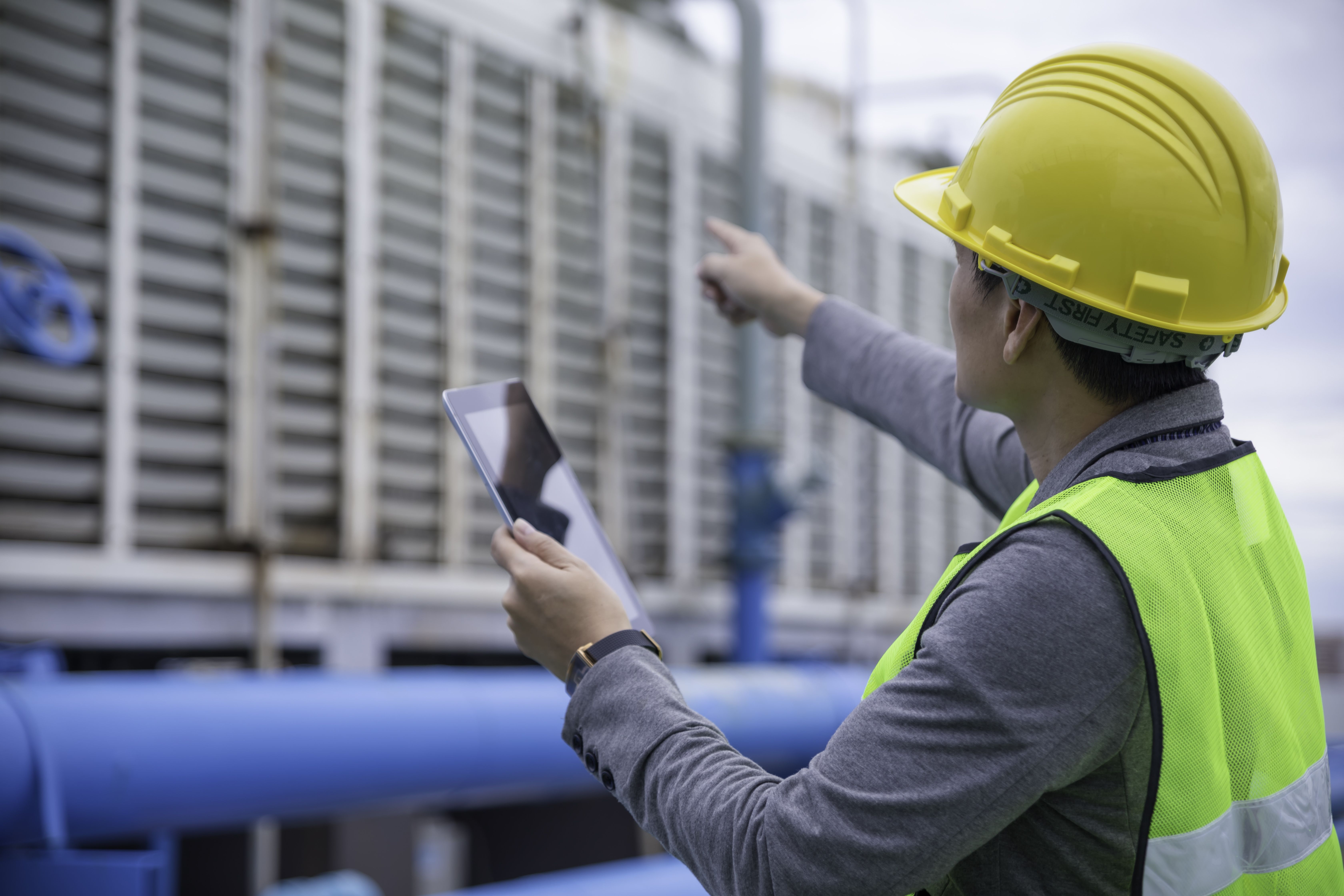 connected worker using tablet in industrial environment