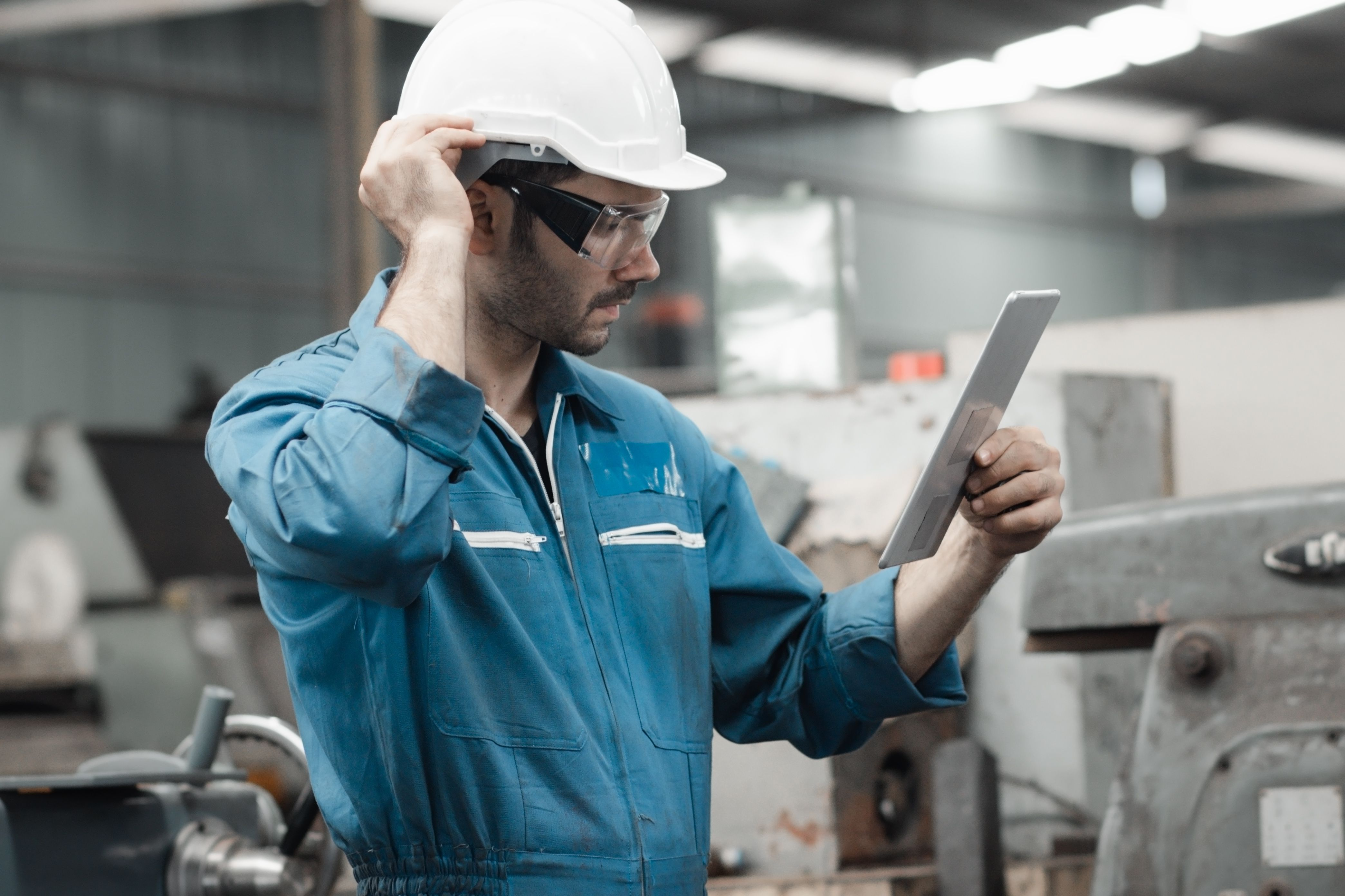 manufacturing worker using tablet